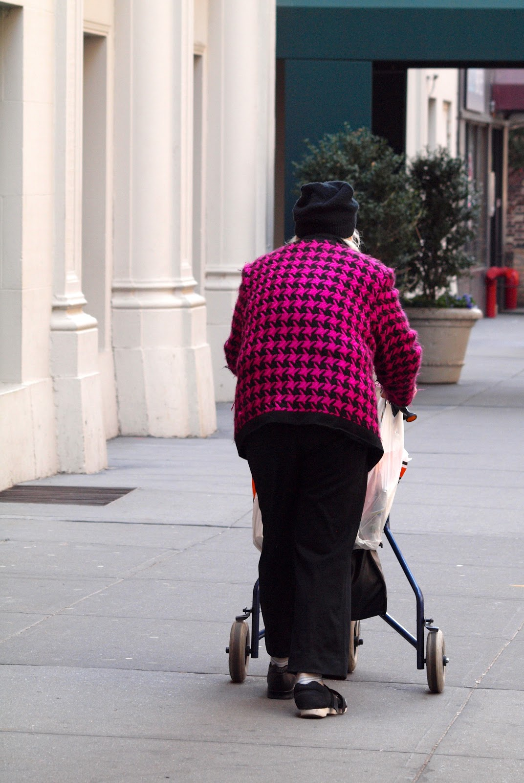 Out and About NYC, older woman walking with stroller