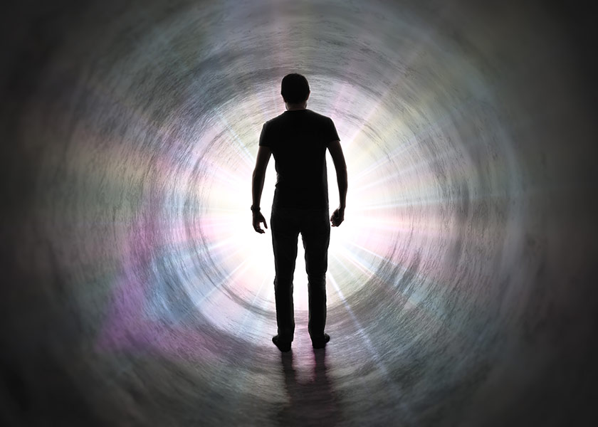 Life After Death Concept - Silhouette Of Man's Soul Is Walking To Bright Light - Rays Of God Inside Tunnel